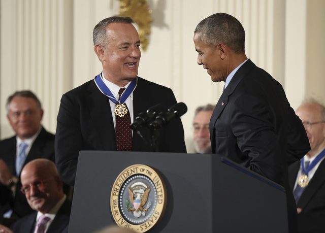 President Barack Obama presents the Presidential Medal of Freedom to actor Tom Hanks during a ceremony in the East Room of the White House Tuesday, Nov. 22, 2016, in Washington. Obama is recognizi ...