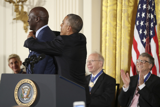 President Barack Obama presents the Presidential Medal of Freedom to former NBA basketball player Michael Jordan during a ceremony in the East Room of the White House Tuesday, Nov. 22, 2016, in Wa ...