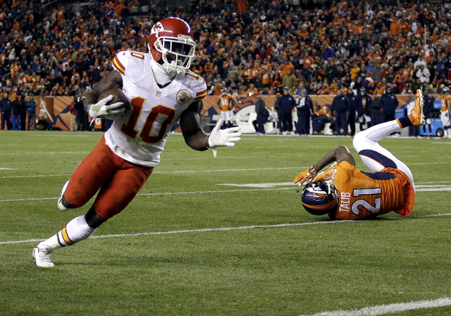 Kansas City Chiefs wide receiver Tyreek Hill (10) runs in for a touchdown against the Denver Broncos during the second half of an NFL football game, Sunday, Nov. 27, 2016, in Denver. (AP Photo/Joe ...