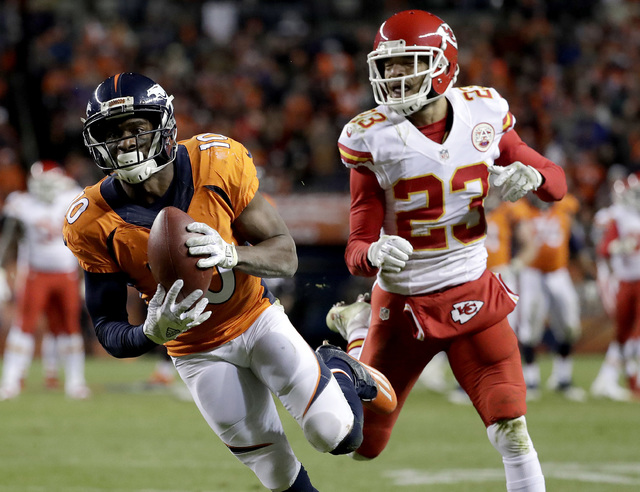 Denver Broncos wide receiver Emmanuel Sanders (10) pulls in a touchdown pass as Kansas City Chiefs cornerback Phillip Gaines (23) defends during the second half of an NFL football game, Sunday, No ...
