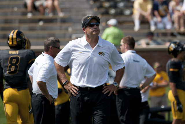 Missouri head coach Gary Pinkel looks up at the crowd during warmups before the start of an NCAA college football game between Toledo and Missouri Saturday, Sept. 7, 2013, in Columbia, Mo. (AP Pho ...