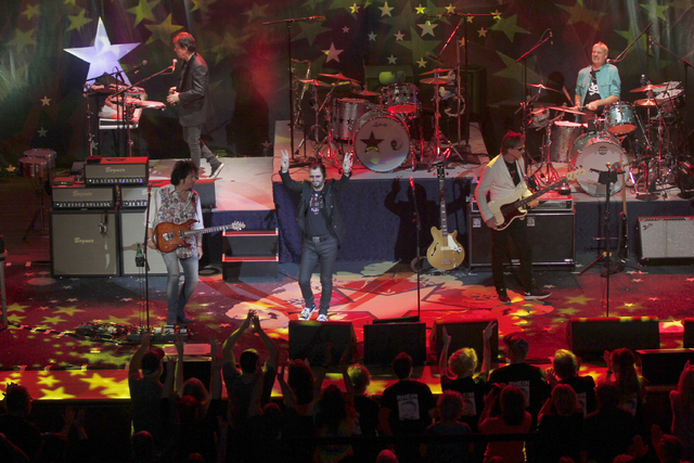 Top left, counter-clockwise, artists Warren Ham, Steve Lukather, Ringo Starr, Richard Page and Gregg Bissonette perform at the Ryman Auditorium on Saturday, June 18, 2016, in Nashville, Tenn. (Lau ...