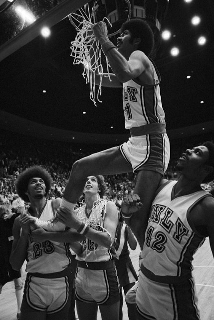 Wins the West University of Nevada, Las Vegas Eddie Owens cuts down the net after winning the NCAA West title by beating Idaho State 107-90 Saturday in Provo, Utah, March 19, 1977. Eddie Owens tie ...