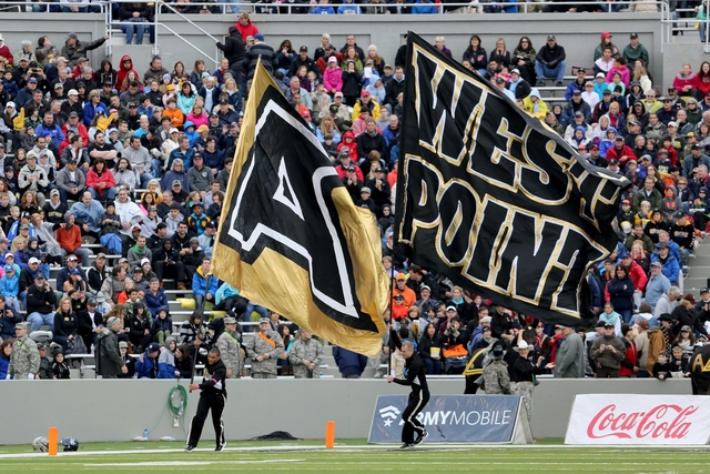 Army Black Knights cheerleaders wave flags after a score against the Rice Owls during a college football game on Saturday, October 11, 2014 in  West Point, NY. Rice won 41-21. (AP Photo/Gregory Payan)