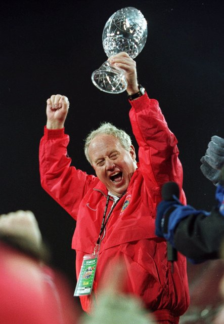 Utah coach Ron McBride cheers after receiving the trophy after Utah defeated Fresno State 17-16 at the Las Vegas Bowl on Saturday, Dec. 18, 1999, in Las Vegas. (Laura Rauch/AP)