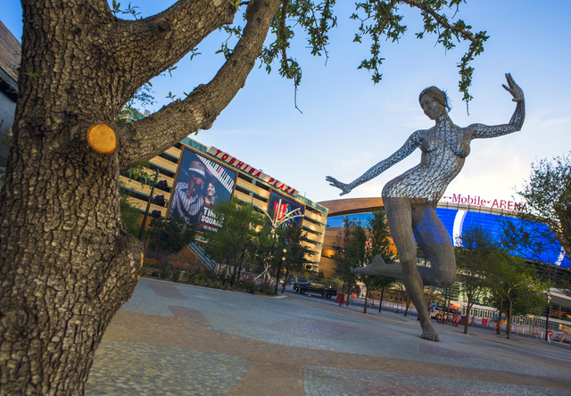 Bliss Dance sculpture created by artist Marco Cochrane is seen with T-Mobile Arena in the background on  Wednesday, March 23, 2016. (Jeff Scheid/Las Vegas Review-Journal Follow @jlscheid)