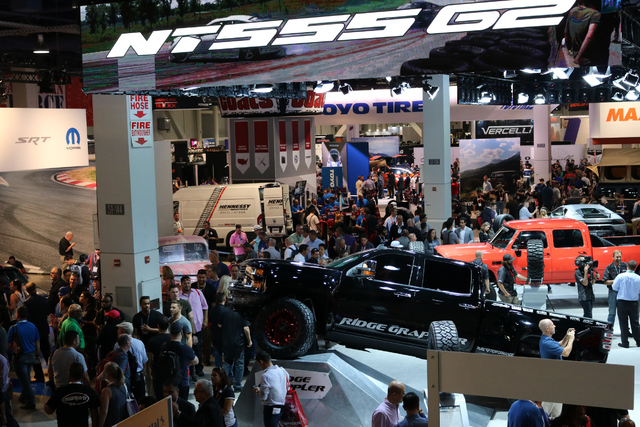 A variety of exhibitors display their tires, cars, and other automotive parts and accessories on the show floor of SEMA at the Las Vegas Convention Center, Tuesday, Nov. 1, 2016. Nicole Raz/Las Ve ...