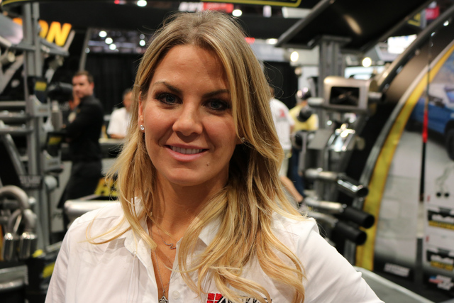 Christine Snedden of Las Vegas-based American Standard Window Film stands in the middle of the show floor at SEMA at the Las Vegas Convention Center, Tuesday, Nov. 1, 2016. She said the number of  ...