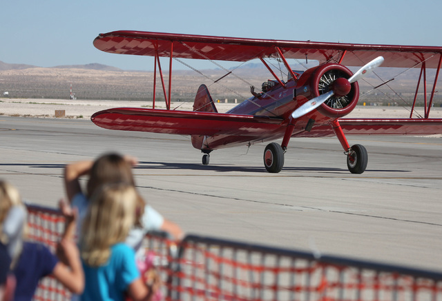 Young girls look on as Vicky Benzing taxies after an airshow performance during the 2016 Aviation Nation air show on Nellis Air Force Base in Las Vegas on Friday, Nov. 11, 2016. Brett Le Blanc/Las ...