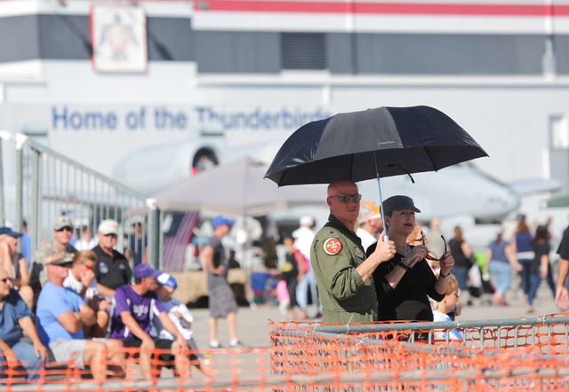 Lt. Col. Todd Tobergte, of 706th Fighter Squadron and who flies with the 64th Aggressor Squadron, left, and his wife Kimberly Tobergte watch the 2016 Aviation Nation air show on Nellis Air Force B ...
