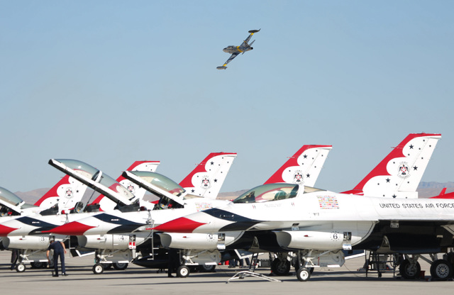 A T-33 passes above the Thunderbirds in front of the audience during the 2016 Aviation Nation air show on Nellis Air Force Base in Las Vegas on Friday, Nov. 11, 2016. Brett Le Blanc/Las Vegas Revi ...