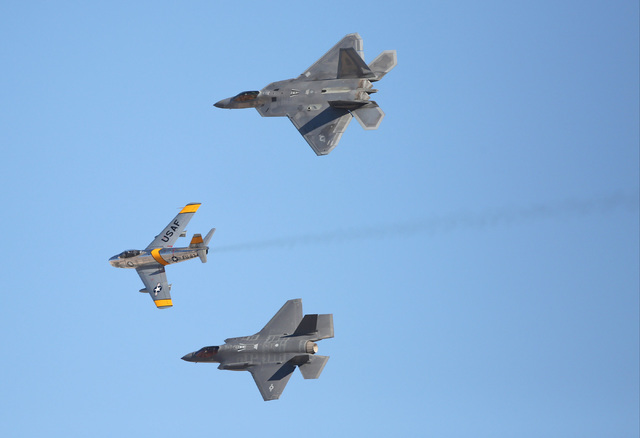 Top to bottom, An F-22, an F-86, and an F-35 perform a pass during the 2016 Aviation Nation air show on Nellis Air Force Base in Las Vegas on Friday, Nov. 11, 2016. Brett Le Blanc/Las Vegas Review ...