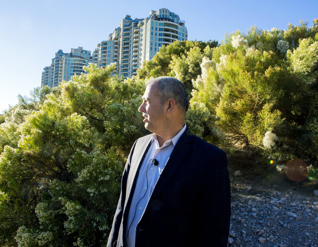 Yohan Lowie, CEO & founder of EHB Companies, stands in the drainage area at Badlands Golf Course near Queensridge Towers on Wednesday, Oct. 9, 2016. EHB Companies are planning on building the  ...