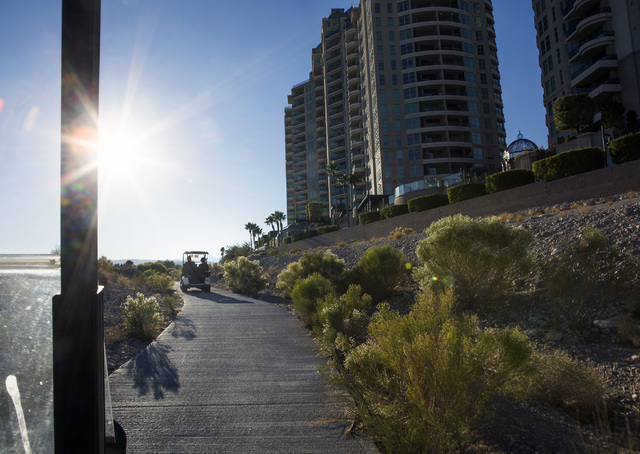 Golf carts travel past Queensridge Towers at Badlands Golf Course on Wednesday, Oct. 9, 2016. Residents are concerned they will loose their views if the controversial, high-density development is  ...