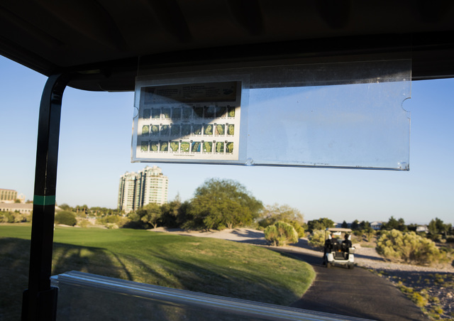 Golf carts travel along the trail at Badlands Golf Course on Wednesday, Oct. 9, 2016. Residents are concerned they will loose their views if the controversial, high-density development is approved ...