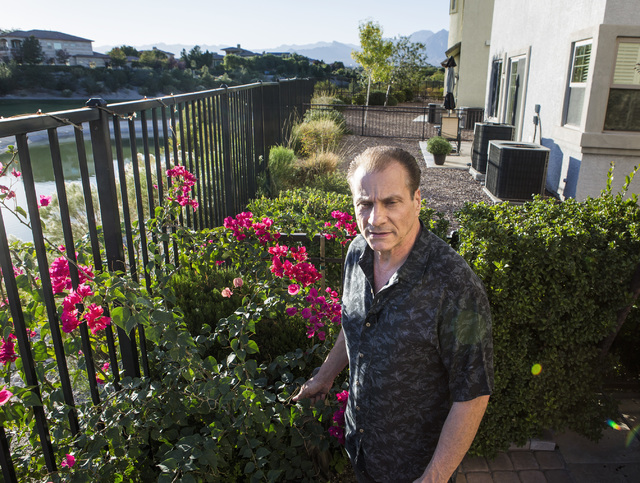 Eddie Canonic views the Badlands Golf Course from his backyard at his townhouse at Tudor Park on Thursday, Oct. 10, 2016. Canonic is concerned that he will lose his view if the controversial, high ...