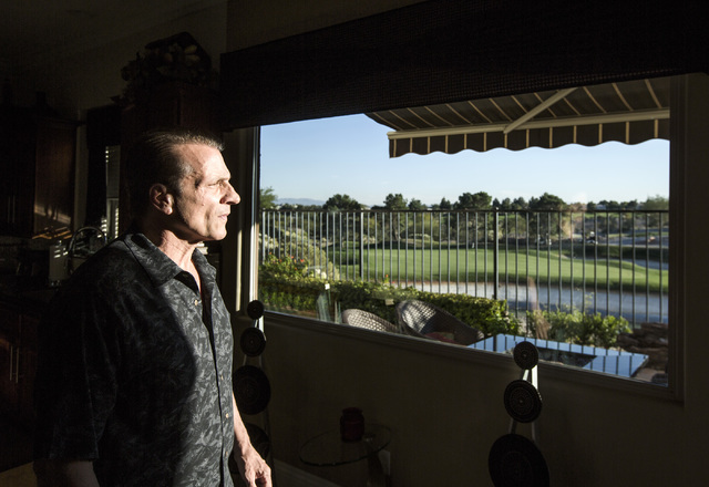 Eddie Canonic views the Badlands Golf Course from his kitchen window in his townhouse at Tudor Park on Thursday, Oct. 10, 2016. Canonic is concerned that he will loose his view if the controversia ...