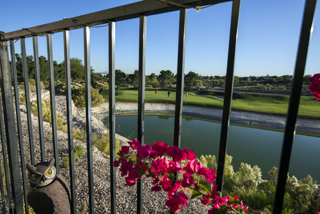 Backyard views from Tudor Park development show golfers putting at the Badlands Golf Course on Thursday, Oct. 10, 2016. Residents are concerned they will loose their views if the controversial, hi ...
