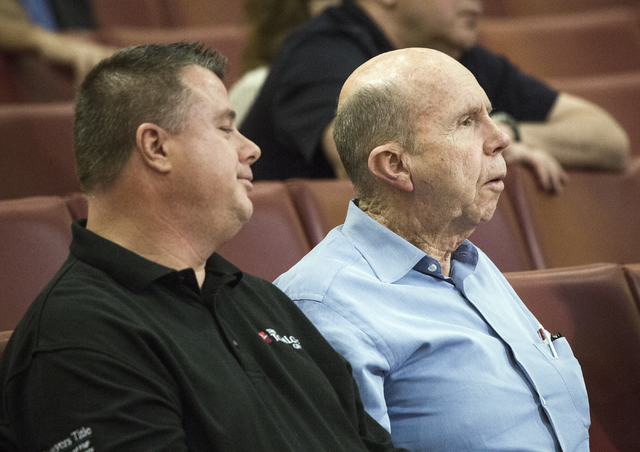 Businessman and homeowner in Queensridge Jack Binion, right, listens during a Las Vegas City Council public hearing on the controversial large-scale development on the Badlands Golf Course on Wedn ...