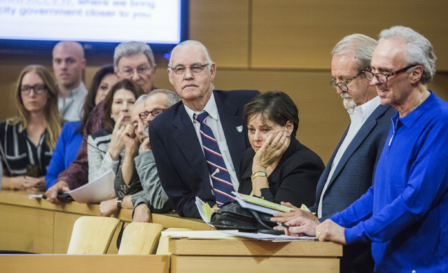 People stand to speak during public comment during the Las Vegas City Council public hearing on the controversial large-scale development on the Badlands Golf Course on Wednesday, Nov., 16, 2016.  ...