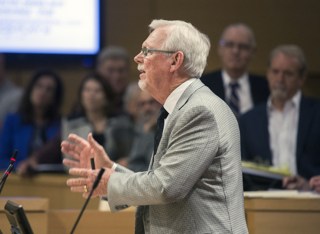 Frank Schreck, attorney and Queensridge resident, speaks out against the controversial large-scale development of the Badlands Golf Course during theLas Vegas City Council public hearing on Wednes ...