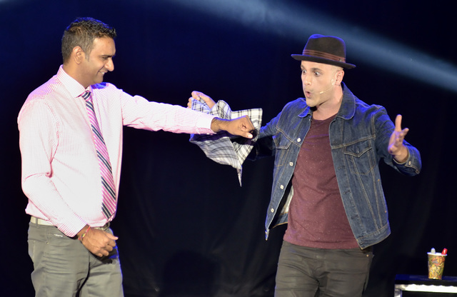 "Magician James Galea, right, performs with the help of an audience member in ""Band of Magicians"" at the Tropicana hotel-casino at 3801 S. Las Vegas Blvd. in Las Vegas on Thursday, No ..."