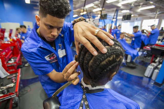 Barber student Todd Elliot, 29, uses a cut-throat razor to fade the hair of customer Keinana Island during class at the Masterpiece Barber College in Las Vegas, Thursday, Oct. 20, 2016. (Richard B ...