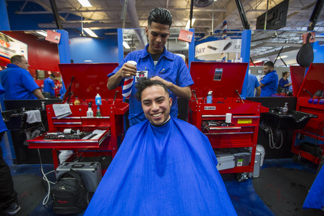 Barber student Gabriel Avila, 21, top, prepares to trim the hair of fellow student Robert Luna, 22, during class at the Masterpiece Barber College in Las Vegas, Thursday, Oct. 20, 2016. (Richard B ...