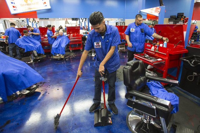 Barber student Gabriel Avila, 21, cleans up after a haircut at Masterpiece Barber College in Las Vegas, Thursday, Oct. 20, 2016. (Richard Brian/Las Vegas Review-Journal Follow @vegasphotograph)