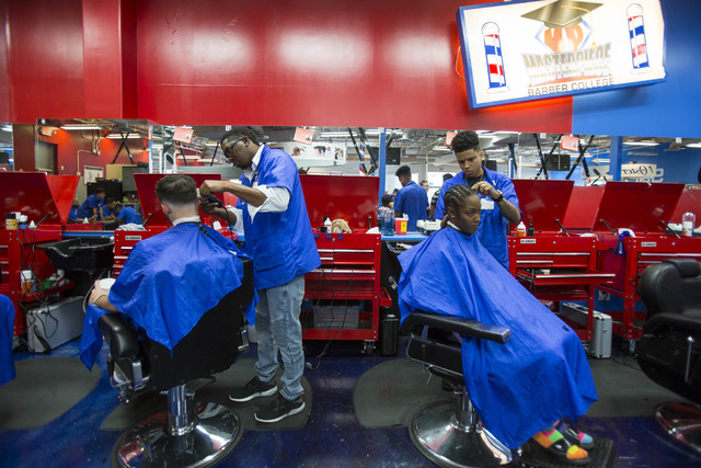 Barber students Don Bryant, second left, and Todd Elliot, right, work on their haircuts at the Masterpiece Barber College in Las Vegas, Thursday, Oct. 20, 2016. (Richard Brian/Las Vegas Review-Jou ...