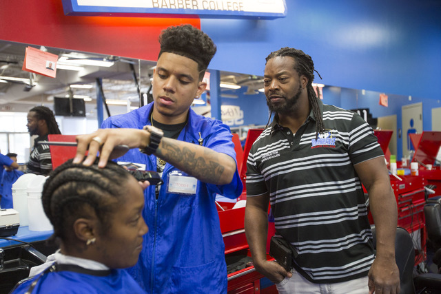 Barber student Todd Elliot, center, fades the hair of customer Keinana Island as instructor Marcus Allen looks on during class at the Masterpiece Barber College in Las Vegas, Thursday, Oct. 20, 20 ...