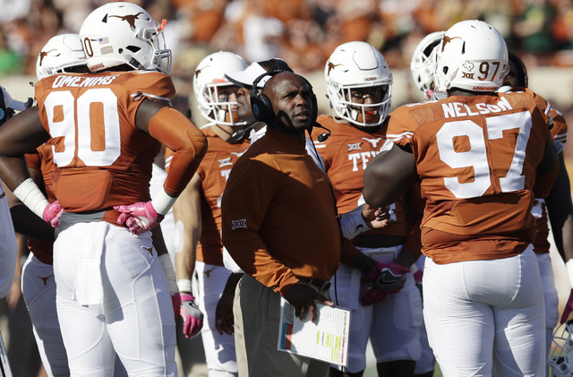 Texas head coach Charlie Strong, center, talks with his players during the first half on a NCAA college football game against Baylor, Saturday, Oct. 29, 2016, in Austin, Texas. (AP Photo/Eric Gay)