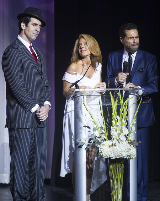 Clint Holmes, from right, and Kelly Clinton present an award to the Mob Museum during the Best of Las Vegas Show at The Venetian Las Vegas hotel-casino on Saturday, Nov. 5, 2016. Loren Townsley/La ...