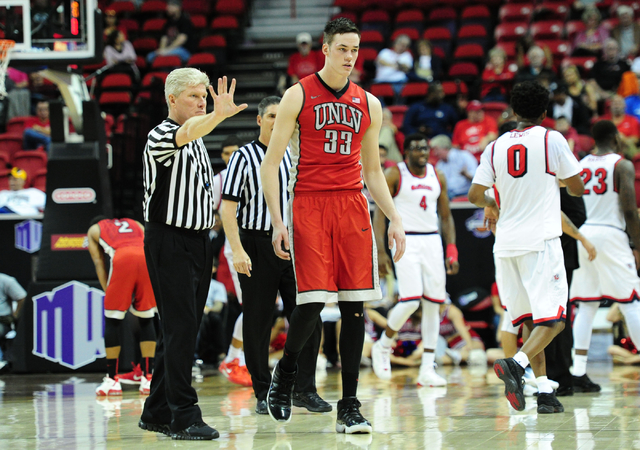 Referee Eric Curry signals fives fouls after UNLV forward Stephen Zimmerman Jr. (33) fouled out of his game against Fresno State in the second half of their Mountain West Conference semifinal bask ...