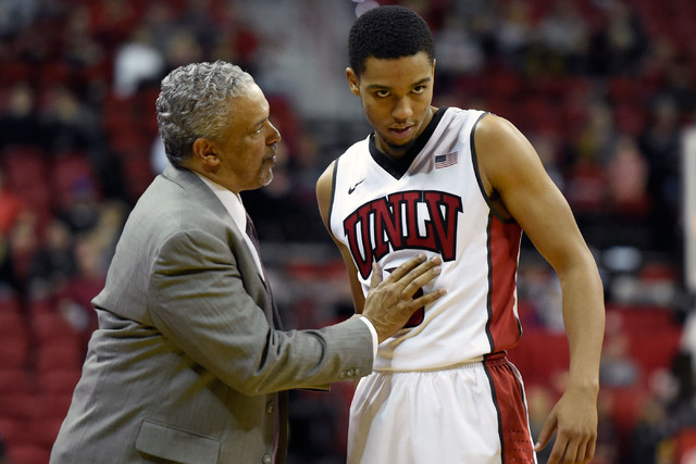 UNLV head coach Marvin Menzies speaks with Jalen Poyser during the second half of an NCAA basketball game against Fullerton at the Thomas & Mack Center Saturday, Nov. 19, 2016, in Las Vegas. U ...