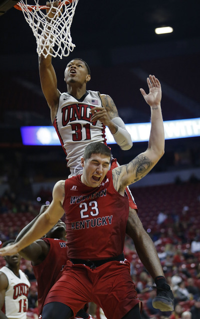 UNLV's Tory Baxter Jr. (31) fells on Western Kentucky's Justin Johnson (23) during the first half of a basketball game at the Thomas & Mack Center in Las Vegas, Saturday, Nov. 26, 2016.  Chito ...