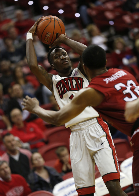 UNLV Rebels guard Kris Clyburn (1) shoots over Western Kentucky Hilltoppers guard Que Johnson (32) during the first half of a basketball game at the Thomas & Mack Center in Las Vegas, Saturday ...