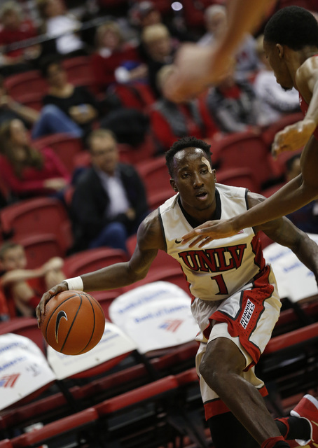 UNLV Rebels guard Kris Clyburn (1) tries to drive past Western Kentucky Hilltoppers players during the first half of a basketball game at the Thomas & Mack Center in Las Vegas, Saturday, Nov.  ...