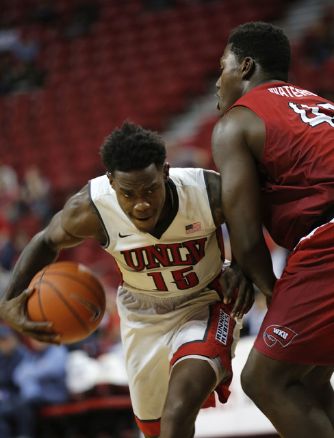 UNLV Rebels forward Dwayne Morgan (15) tries to drive past Western Kentucky Hilltoppers forward Anton Waters (42) during the second half of a basketball game at the Thomas & Mack Center in Las ...
