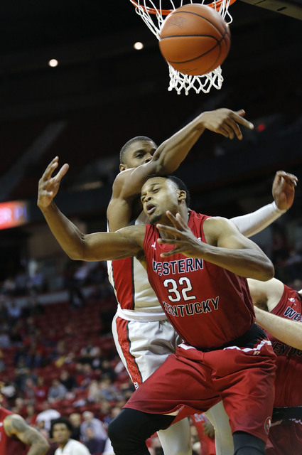 UNLV Rebels forward Tyrell Green (3) and Western Kentucky Hilltoppers guard Que Johnson (32) battle for a loose ball during the second half of a basketball game at the Thomas & Mack Center in  ...