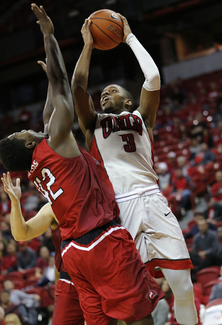 UNLV Rebels forward Tyrell Green (3) shoots over Western Kentucky Hilltoppers forward Anton Waters (42) during the second half of a basketball game at the Thomas & Mack Center in Las Vegas, Sa ...