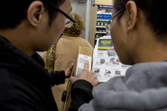 Bang Luu, left, and Ivan Luu, Black Friday shoppers, look at a laptop during the sale at the Best Buy in Summerlin, Thursday, Nov. 24, 2016. Elizabeth Page Brumley/Las Vegas Review-Journal Follow  ...