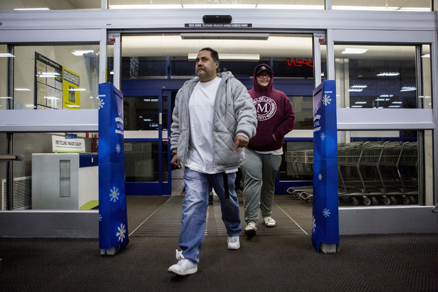 Nico Garcia, center, and Nico Garcia Jr., Black Friday shoppers that had camped outside of the Best Buy in Summerlin since Saturday, Nov. 19, 2016, are the first to enter the store to shop, Thursd ...