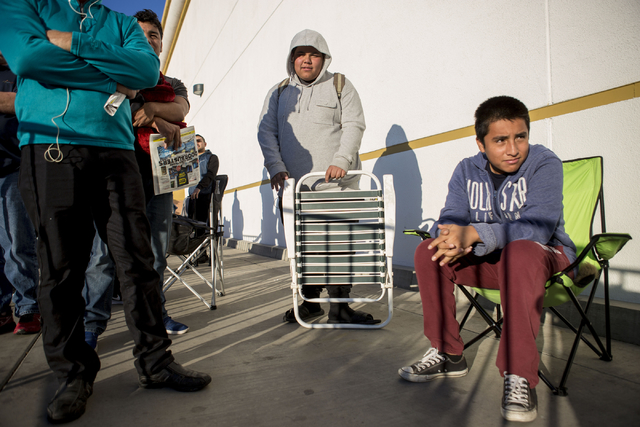 Justin Manriquez, 17, center, and Uriel Gonzalez, 15, Black Friday sale shopper, wait outside of the Best Buy on the cross streets of North Rainbow Blvd and West Lake Mead Blvd, Thursday, Nov. 24, ...