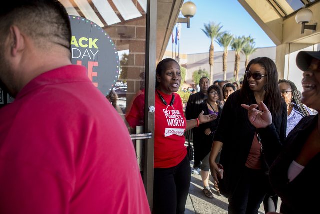 Sheila Frazier, a JCPenney employee, greets customers as they enter the store for the Black Friday sales in Meadows Mall, Las Vegas, Thursday, Nov. 24, 2016. Elizabeth Page Brumley/Las Vegas Revie ...