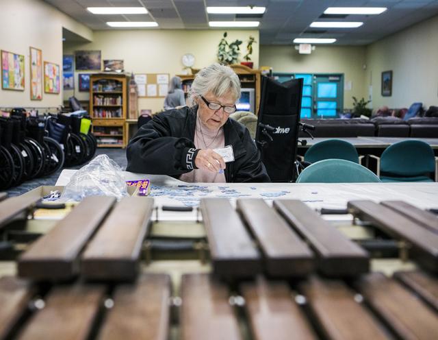 Client Ellen Jackson places a piece to a puzzle at Nevada Senior Services Adult Day Care Of Las Vegas, 901 N. Jones Blvd. on Tuesday, Nov. 22, 2016.  Jeff Scheid/Las Vegas Review-Journal Follow @j ...