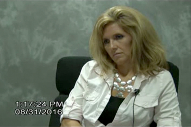 During a deposition on Aug. 31, 2016, Rhonda Borgia answers questions regarding her investigation into the death of attorney Susan Winters. (Courtesy video screen capture)