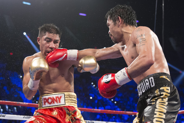 Manny Pacquiao, right, connects a right punch against Jessie Vargas in their welterweight WBO World Title bout at the Thomas & Mack Center on Saturday, Nov. 5, 2016, in Las Vegas. Pacquiao won ...