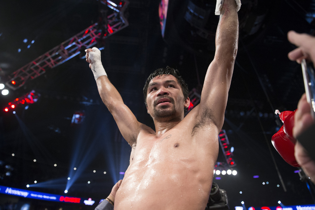 Manny Pacquiao reacts after his unanimous victory against Jessie Vargas in their welterweight WBO World Title bout at the Thomas & Mack Center on Saturday, Nov. 5, 2016, in Las Vegas. Erik Ver ...