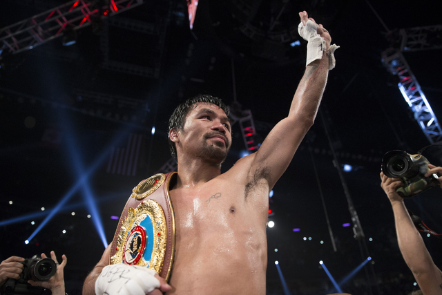 Manny Pacquiao reacts after his unanimous decision victory against Jessie Vargas in their welterweight WBO World Title bout at the Thomas & Mack Center on Saturday, Nov. 5, 2016, in Las Vegas. ...